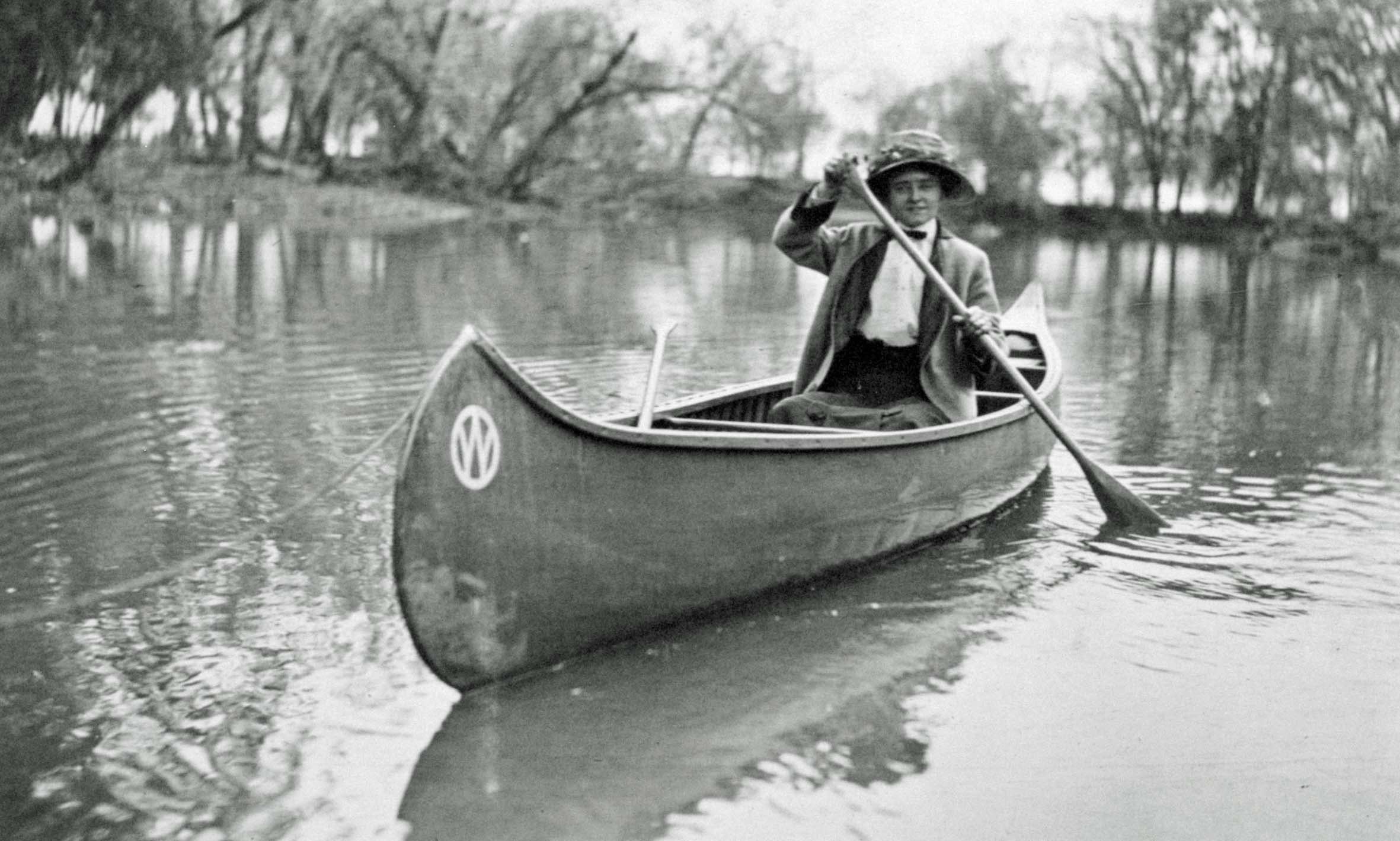 Woman paddles canoe on Vermillion River